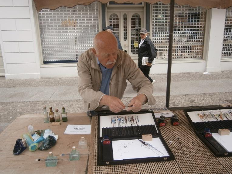 Glass pen seller at Potsdam's Russian Quarters market